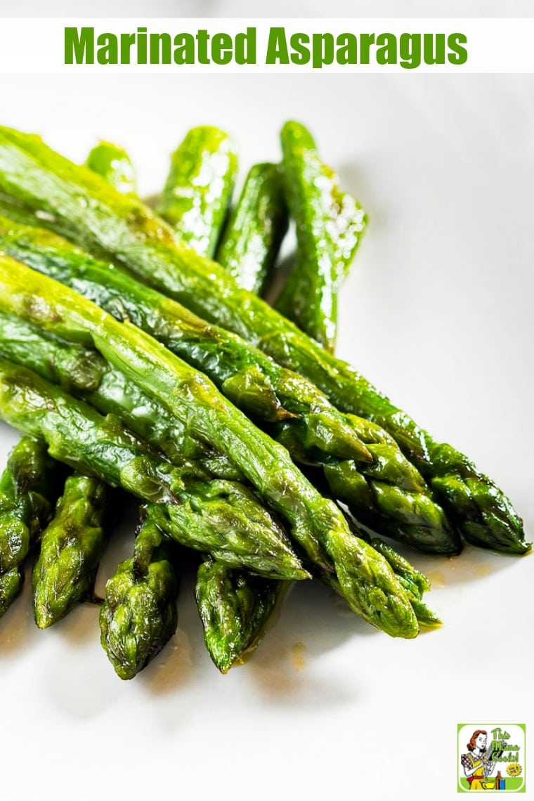 A white plate of cooked asparagus