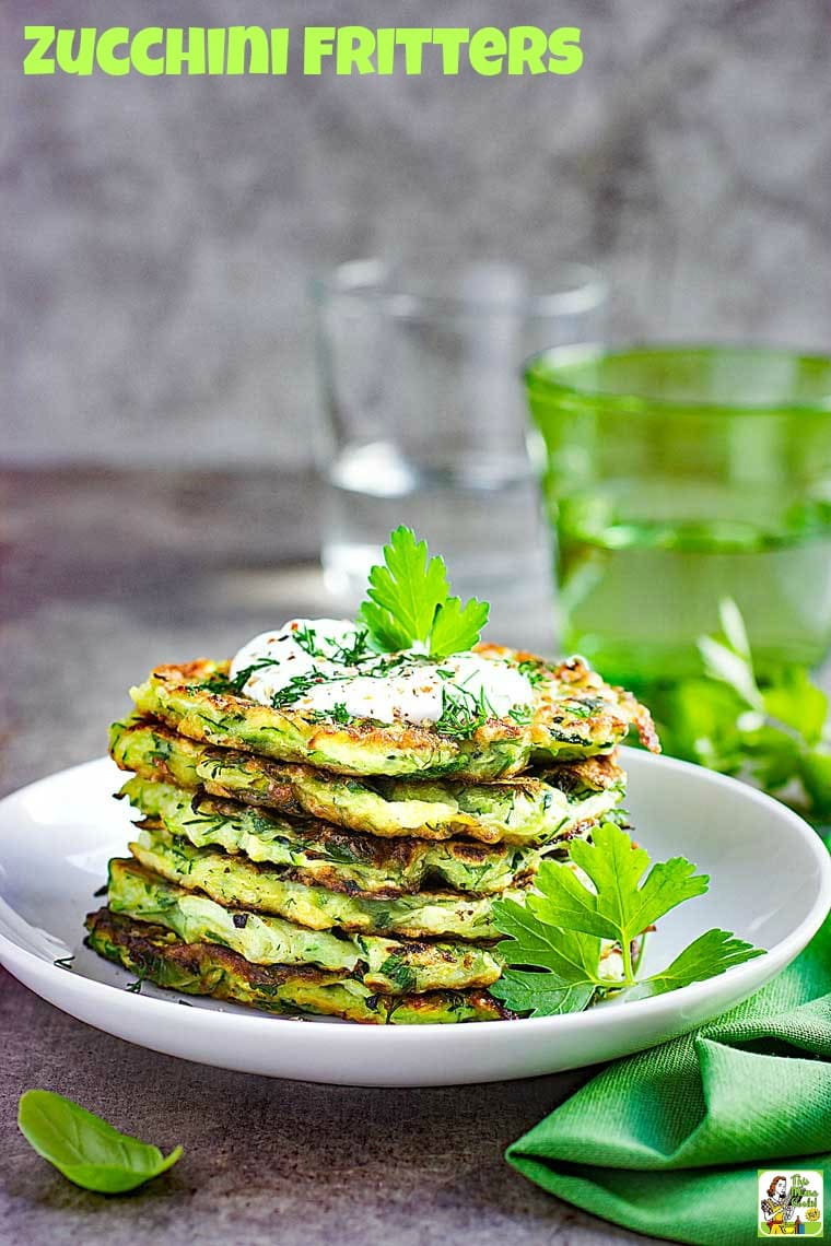 Zucchini fritters are a great way to use up zucchini from your garden. This zucchini fritters recipe is gluten free and dairy free. Serve up these zucchini pancakes for breakfast or dinner with Greek yogurt, apple sauce or ketchup! #pancaketuesday #recipes #recipeoftheday #healthyrecipes #easyrecipe #easyrecipe #breakfast #brunch #dinner #fritters #zucchinifritters #pancakes #pancakerecipes #pancakesfromscratch #pancakeday #zucchini #zucchinipancake #zucchinipancakes