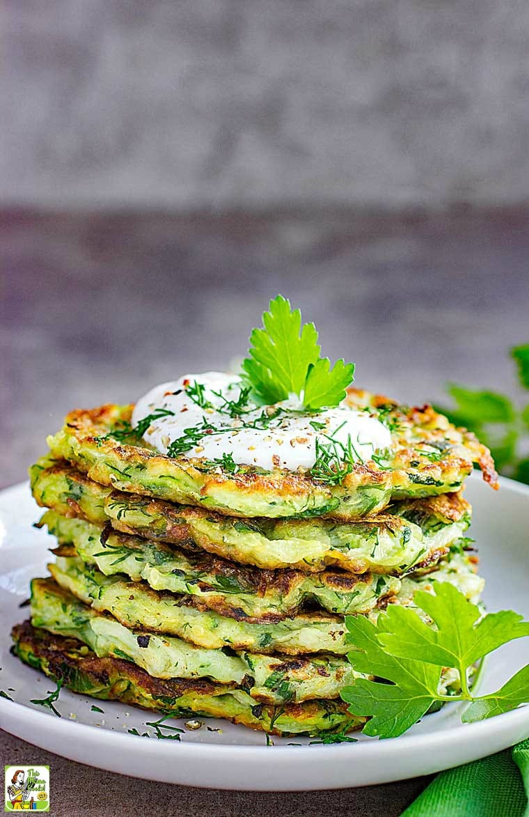 Plate of Zucchini Fritters with a dollop of Greek yogurt