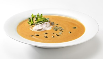 Creamy Pumpkin Soup with Cinnamon Creama and Roasted Pumpkin Seeds
