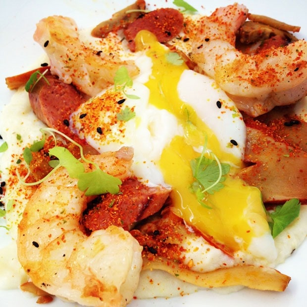 Grilled shrimp on grits with sausage, lobster mushrooms and poached egg
