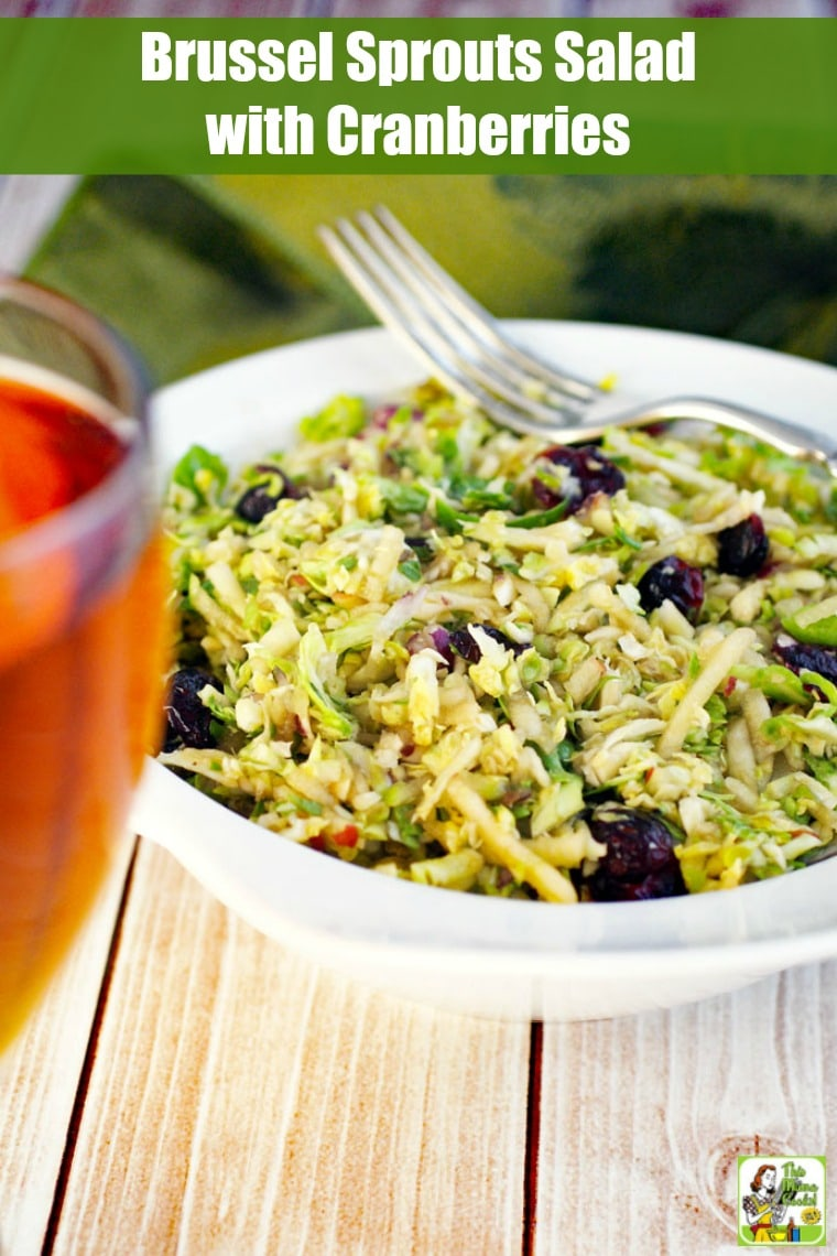 This Brussel Sprouts Salad with Cranberries is easy to make ahead of time. Make Brussels sprout slaw for holiday meals or weeknight dinners. #recipes #easy #recipeoftheday #glutenfree #easyrecipe #easyrecipes #glutenfreerecipes #vegetarian #vegetarianrecipes #veganfood #vegan #veganrecipes #salad #saladrecipes #sidedish #coleslaw