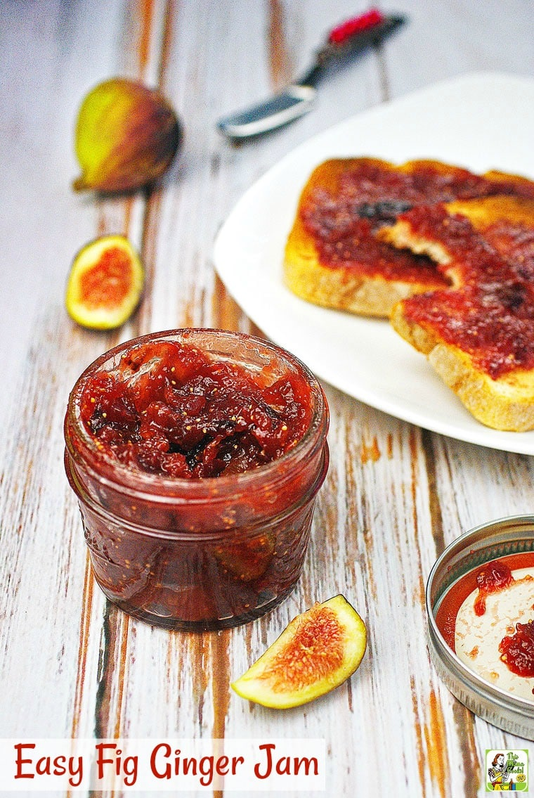 A jar of fig jam with fig jam toast on a white plate in the background.
