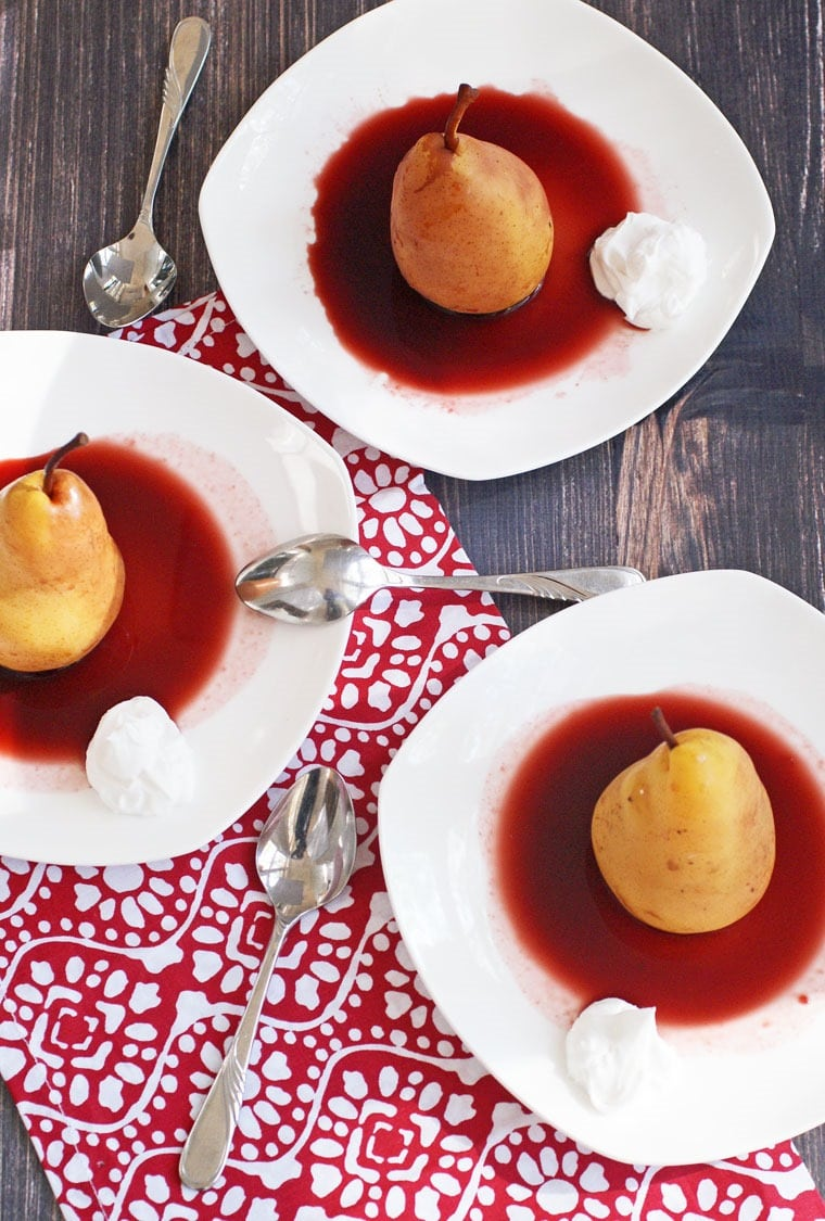 A healthy dessert that's also vegan, dairy free and gltuen free. Try this recipe for Slow Cooker Cherry Poached Pears with Coconut Cream at This Mama Cooks! On a Diet - thismamacooks.com