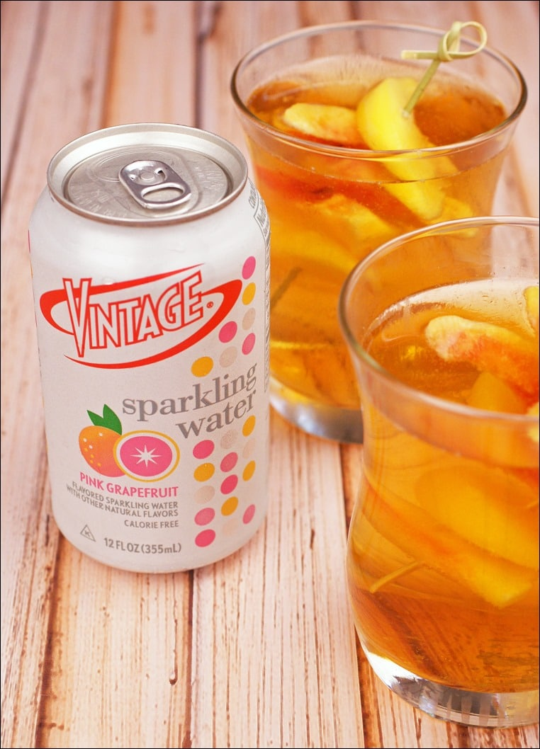 This peach whiskey spritzer is made with Pink Grapefruit Vintage Sparkling Water. Get the recipe for Georgia On My Mind Peach Whiskey Spritzer Cocktail at This Mama Cooks! On a Diet