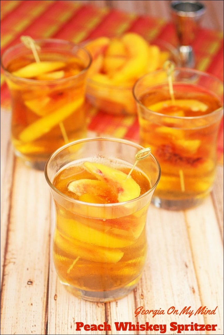Looking for a refreshing and light spritzer cocktail for hot summer days? Try my Georgia On My Mind Peach Whiskey Spritzer Cocktail. Get the recipe at This Mama Cooks! On a Diet