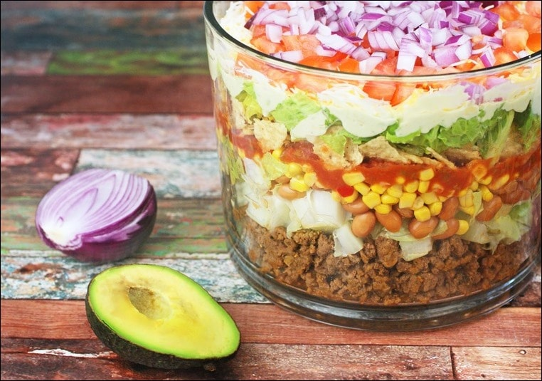 Layered Chopped Taco Salad. Make this salad recipe in under 30 minutes. From This Mama Cooks! On a Diet