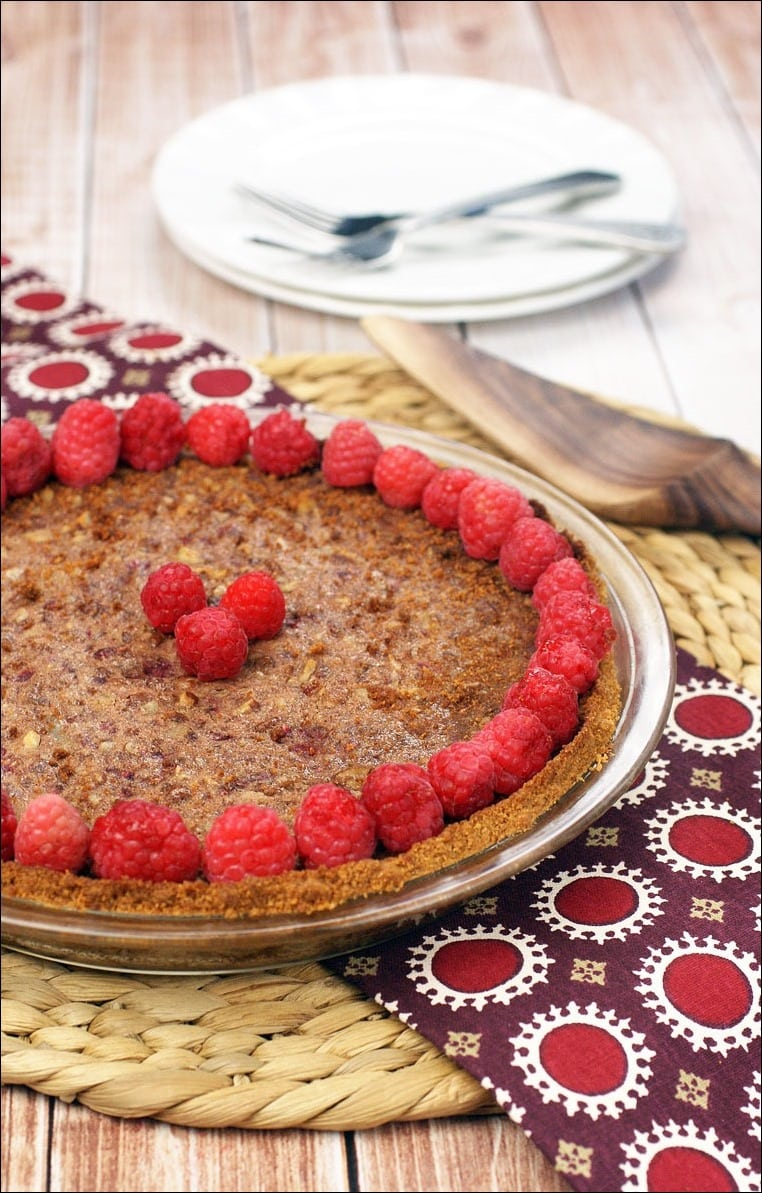 Need a gluten free dessert recipe for Thanksgiving? Try this Gluten Free Raspberry Pecan Pie. Get the easy recipe including a homemade gluten free cookie pie crust recipe at This Mama Cooks! On a Diet