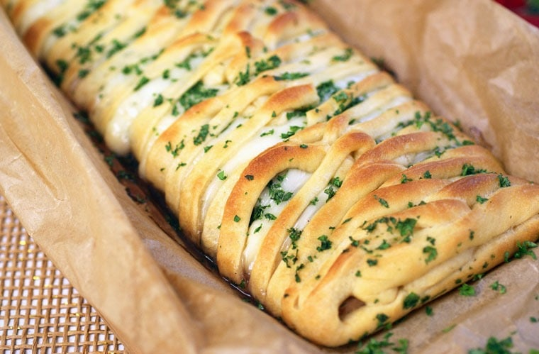 Turkey Cranberry Crescent Braid. A great way to use Thanksgiving leftovers. And it's an easy to make party appetizer that your guests will love! Get this crescent dough recipe at This Mama Cooks! On a Diet