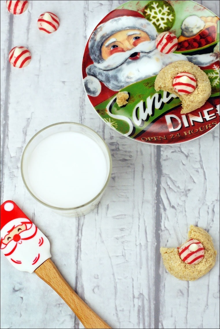 Don't forget to make a batch of holiday cookies for Santa! Get the recipe for these gluten free holiday cookies at This Mama Cooks! On a Diet. These Easy Gluten Free Peppermint Blossom Cookies can also be made dairy free!
