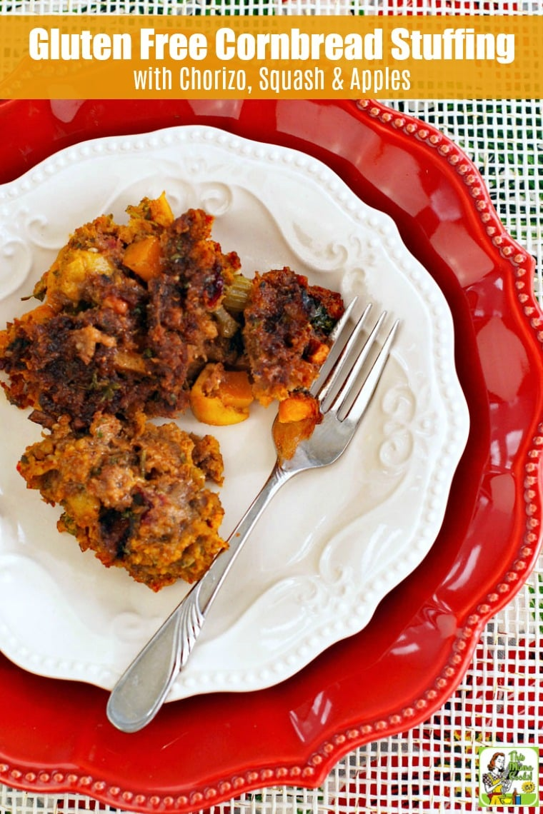 white and red plate with fork and cornbread stuffing with chorizo, squash and apples on a white background.