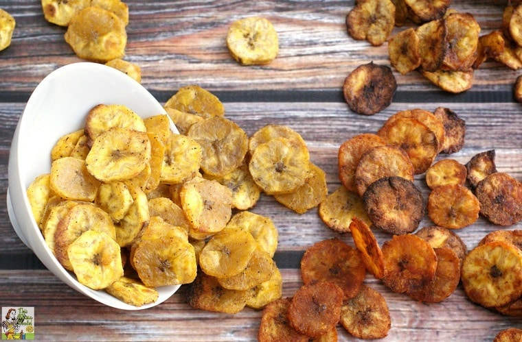 Baked plantain chips in a white bowl.