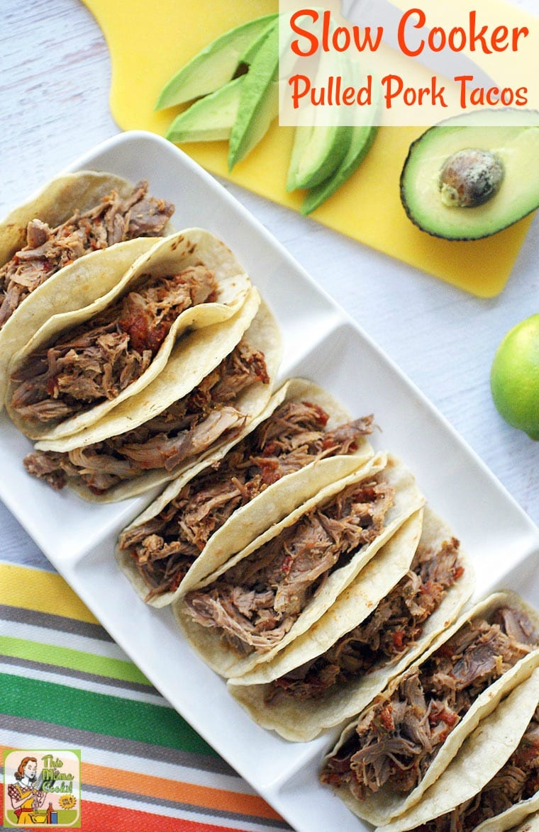 A platter of Slow Cooker Pulled Pork Tacos with avocados