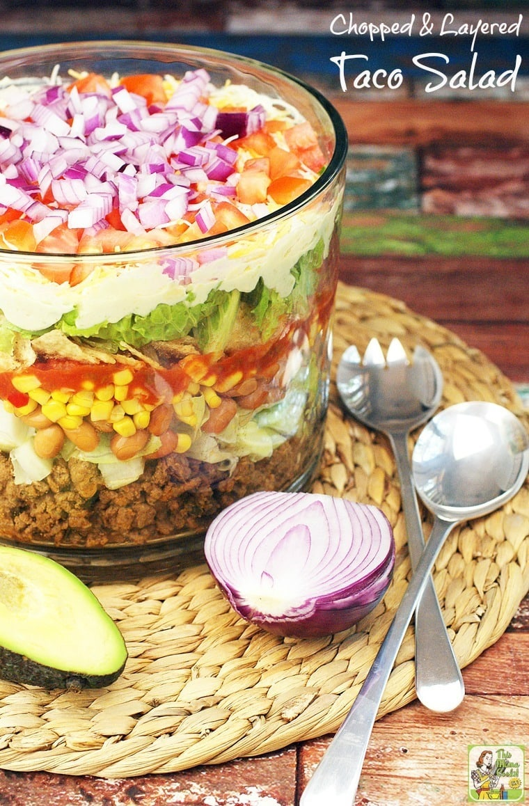 Need a salad recipe to bring to a potluck? Try this Layered Chopped Taco Salad. #tacosalad #salad #mexicanfood #healthyrecipe #healthyrecipes #tacos #easyrecipe #groundmeat #beef