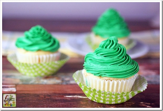 Three filled cupcakes with green icing.