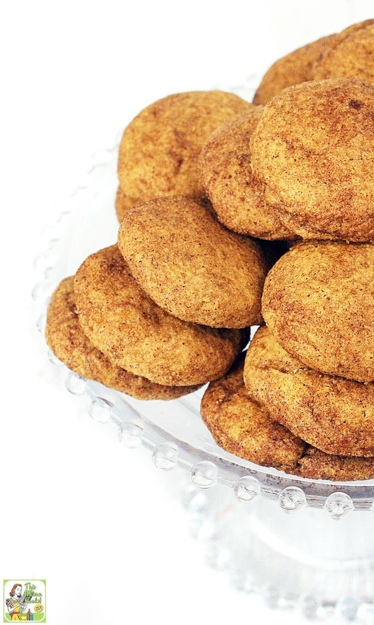 Close up of a pile of gluten free rice flour snickerdoodle cookies with cinnamon sugar on a glass plate.