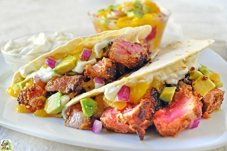 Do you love pan seared ahi tuna recipes? Then make these healthy Ahi Tuna Tacos with Wasabi Cream and Mango Avocado Salsa for dinner or a party!
