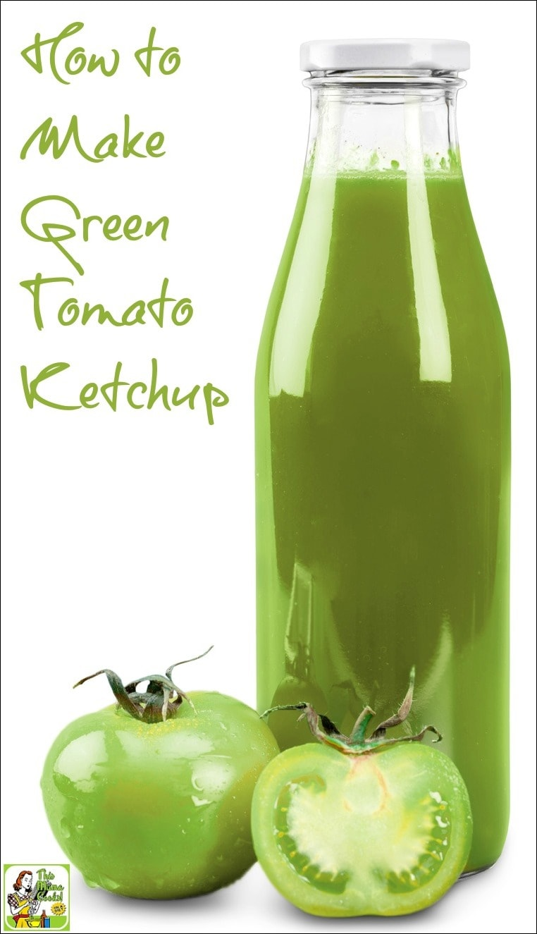 A bottle of green tomato ketchup with a couple of green tomatoes.