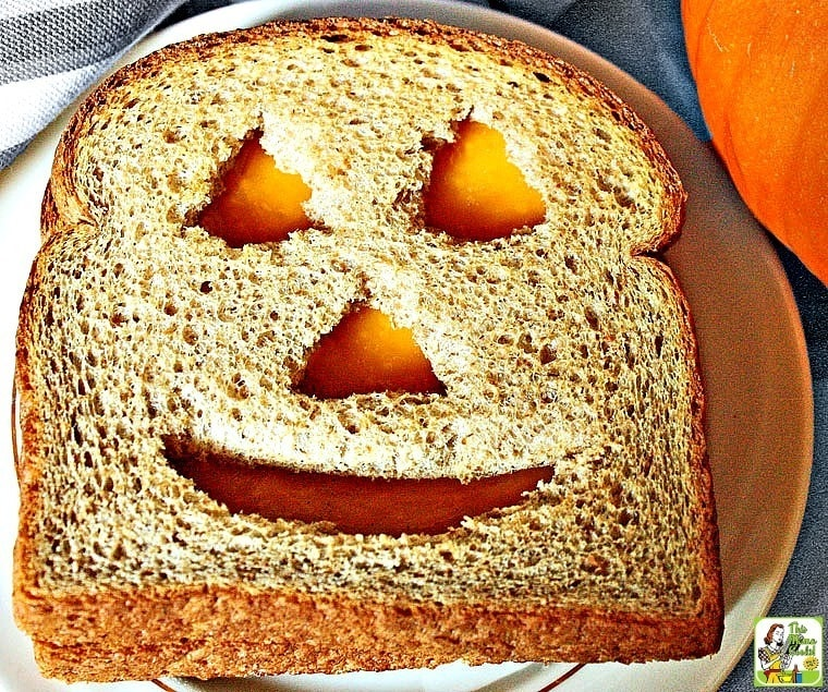 Need Halloween sandwich ideas kids love? Make a Jack-O-Lantern Cheese Sandwich!