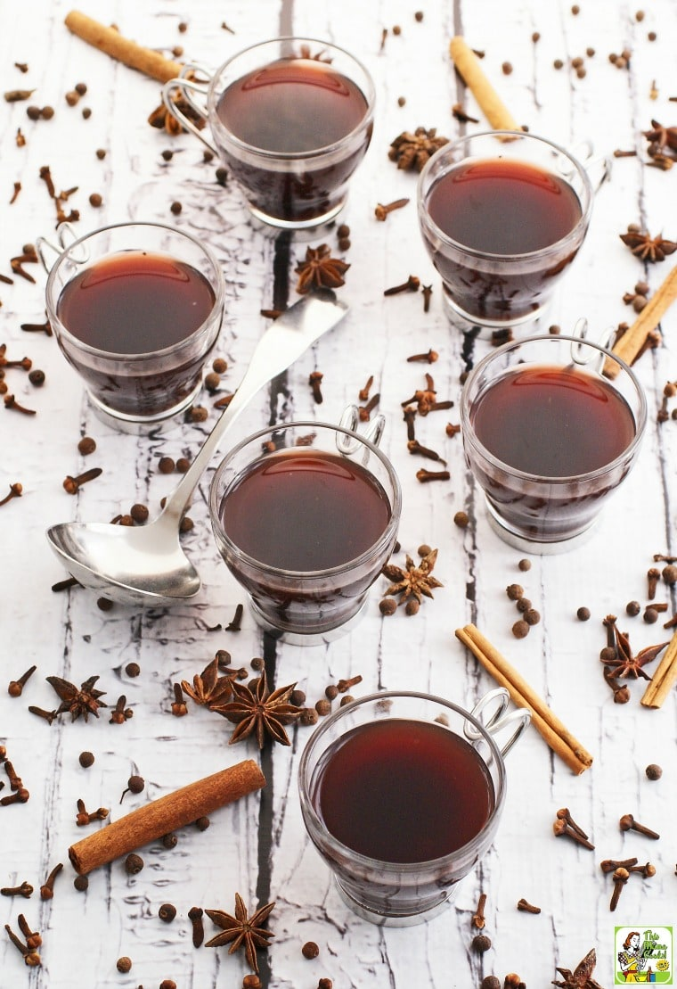 Hot mulled wine in glasses with spices