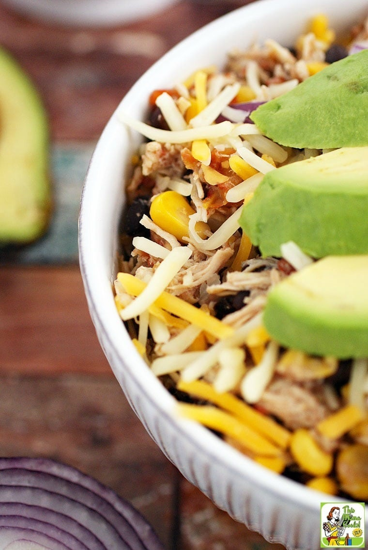 Crock-Pot Mexican Shredded Chicken with Black Beans & Corn. Perfect shredded chicken taco recipe or shredded chicken burrito recipe.