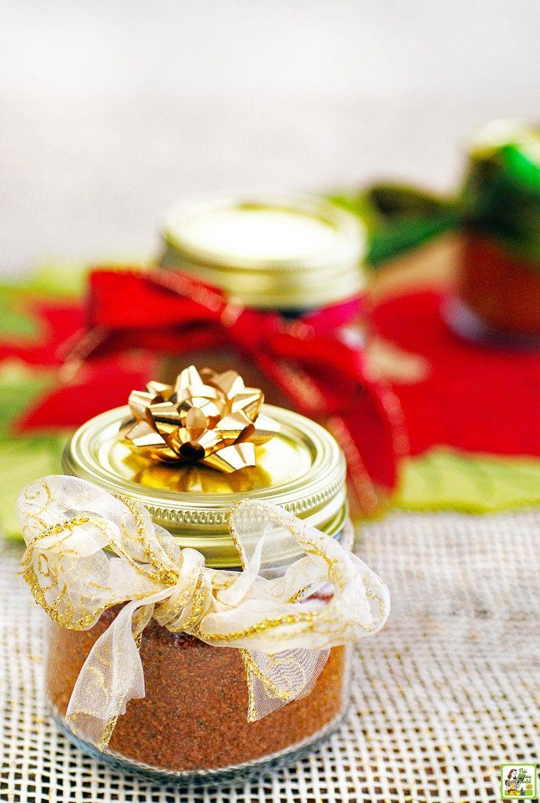 Jars of homemade taco seasoning with festive ribbons and bows.