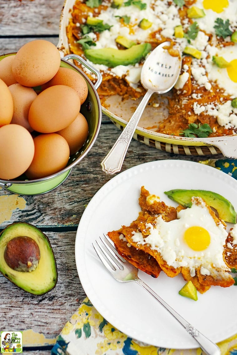 A plate of breakfast chilaquiles with eggs and avocados