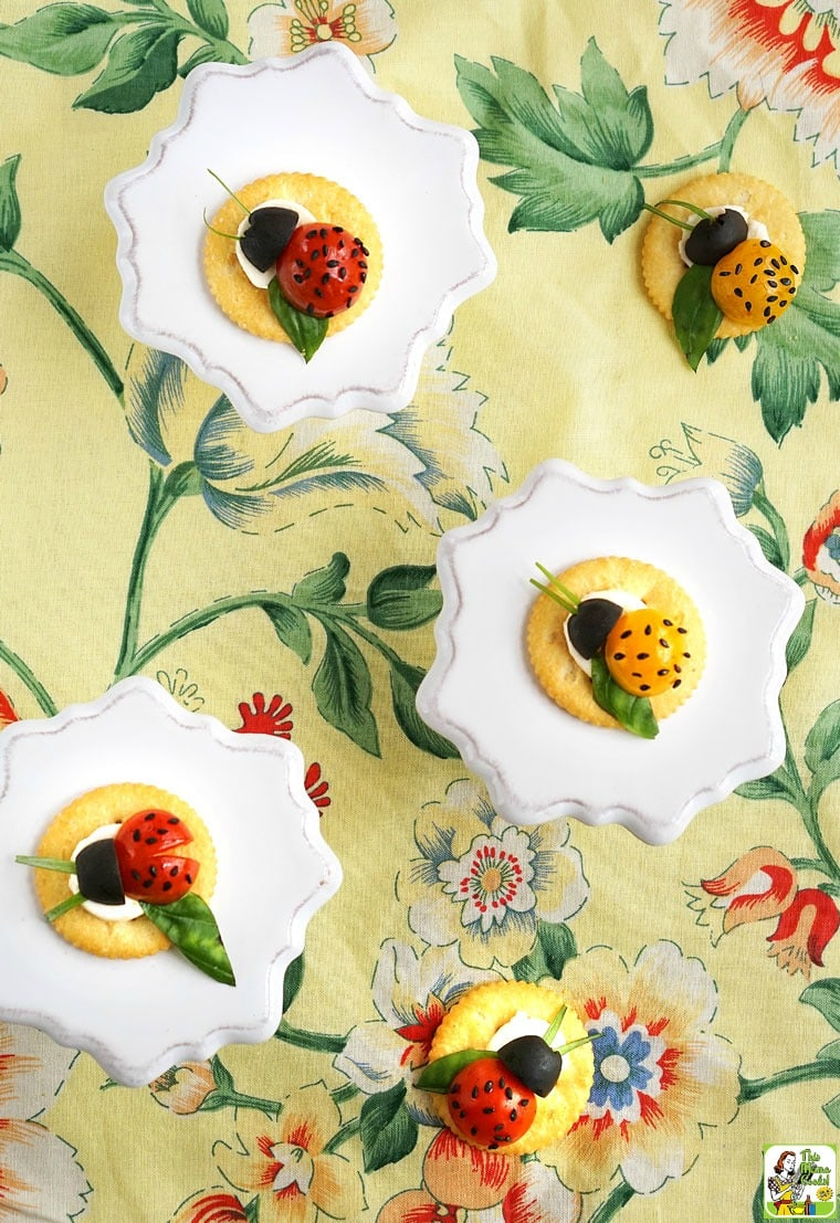 Caprese Ladybugs snack cracker appetizers on a floral napkin.