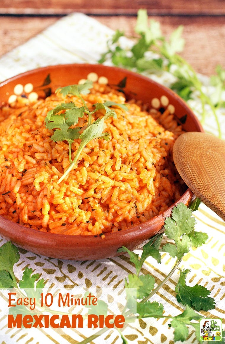 A bowl of Easy Mexican Rice  with cilantro and wooden spoon.