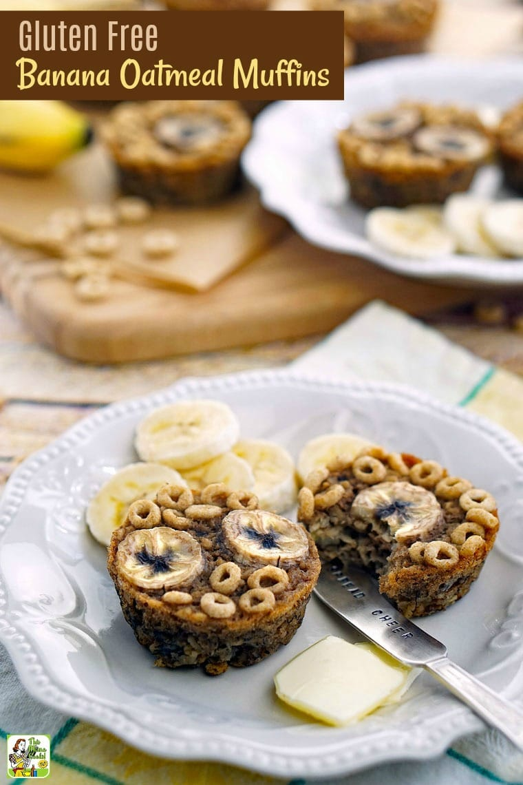 Two Banana Oatmeal Muffins on a white plate with slices of banana and butter pats