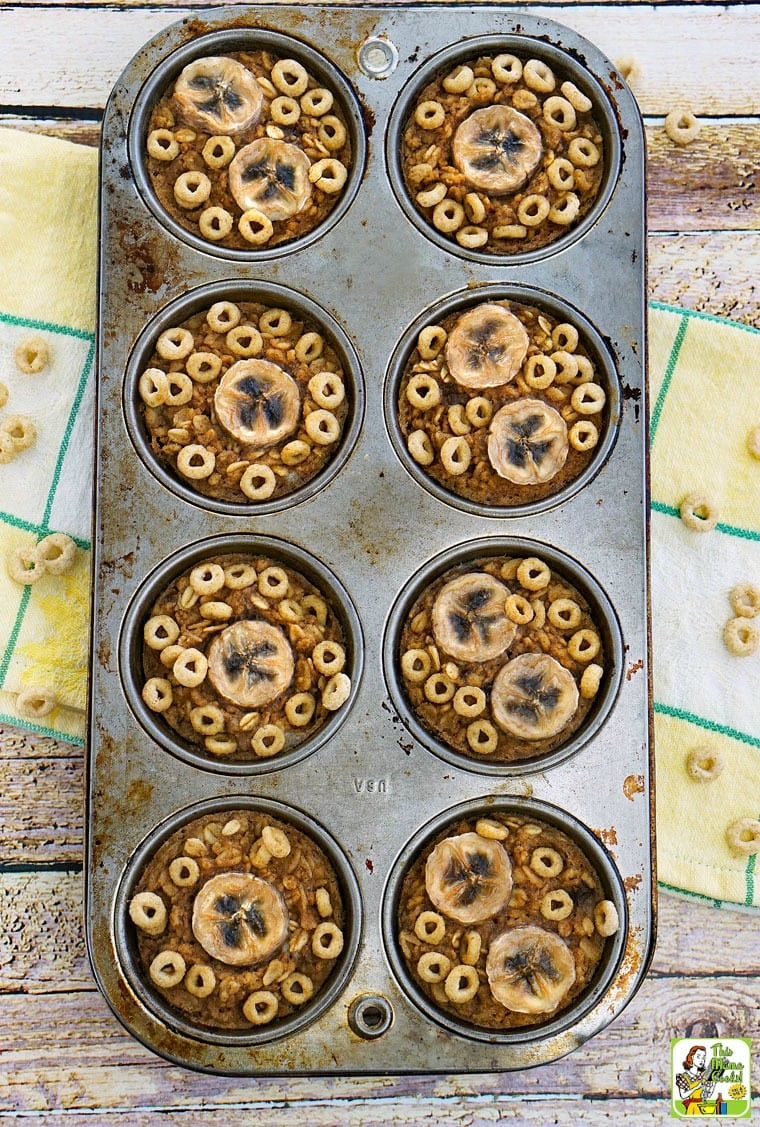 Banana Oatmeal Muffins in a muffin pan on a yellow and white dish towel