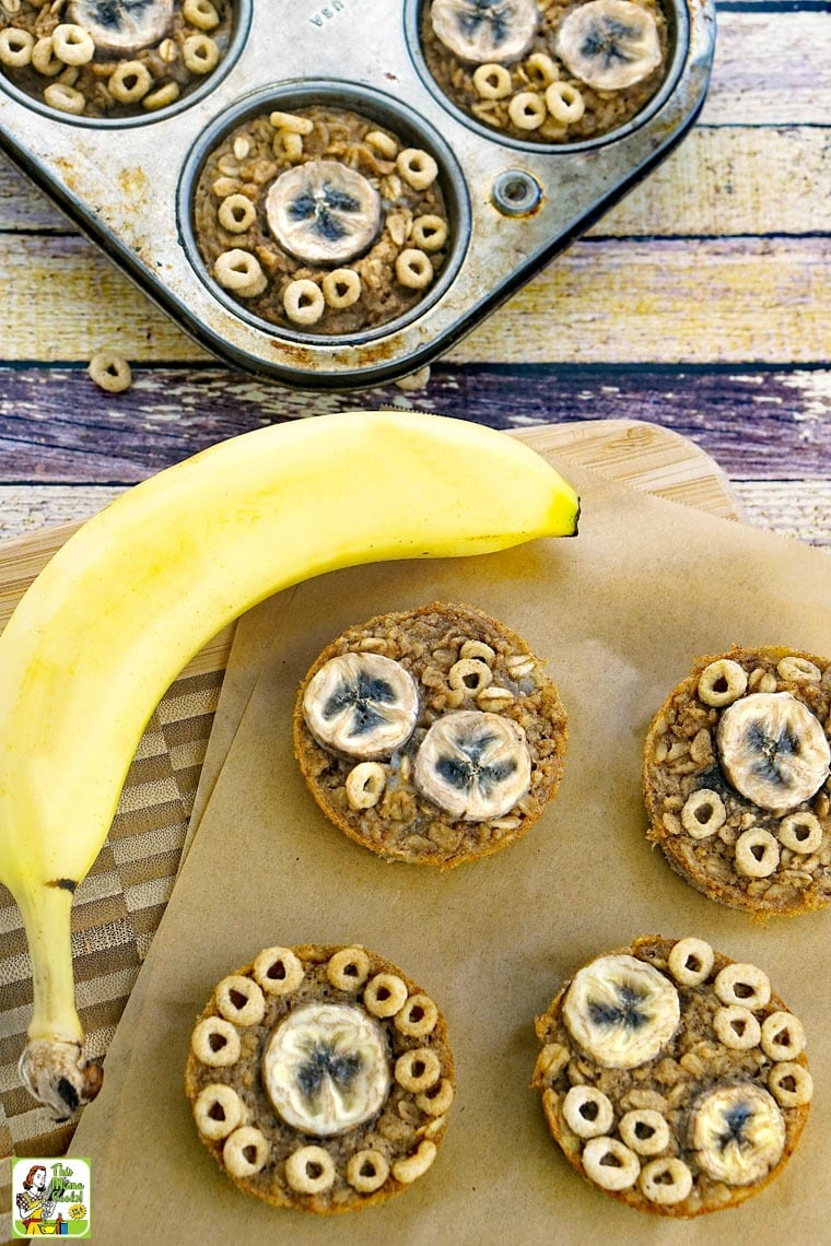 Banana Oatmeal Muffins on a white plate and on cutting board with parchment paper