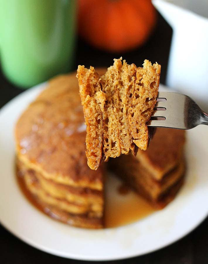 healthy pumpkin recipes: a stack of Vegan Gluten Free Pumpkin Pancakes