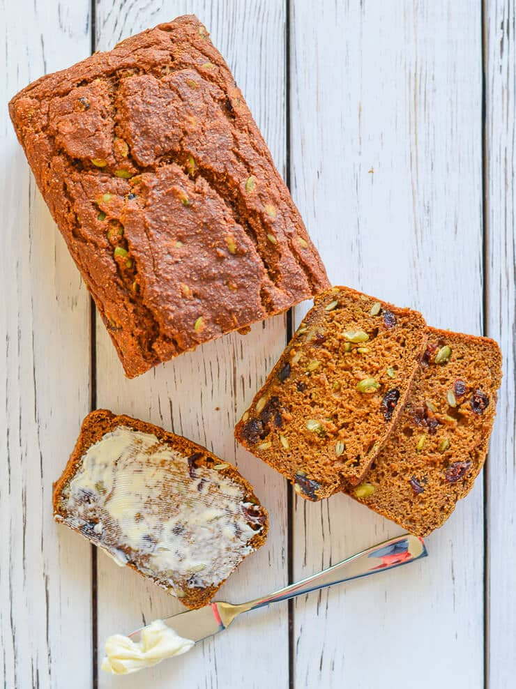 healthy pumpkin recipes: slices of Vegan Pumpkin Bread with Cranberries & Pumpkin Seeds
