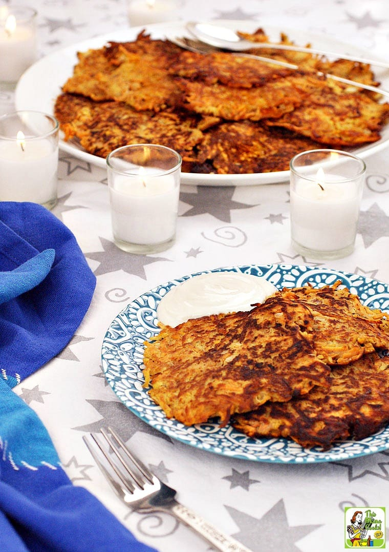 Plates Sweet Potato Pancakes with candles and a blue napkin