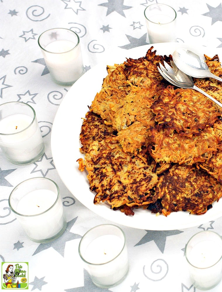 A platter of Sweet Potato Pancakes with candles and serving spoon and fork
