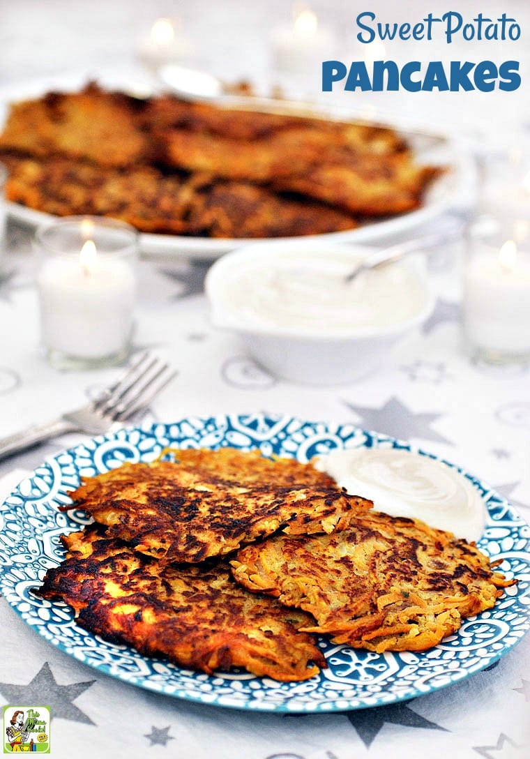 A plate of Sweet Potato Pancakes with sour cream or Greek yogurt