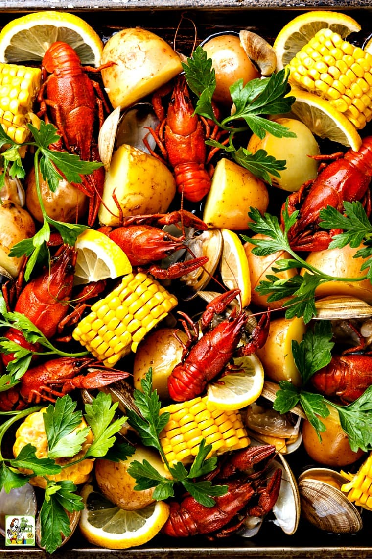 A Cajun seafood boil with boiled crawfish, corn on the cob, potatoes, and clams.