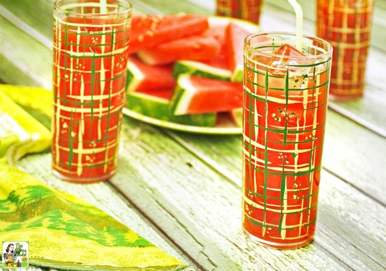 Glasses of watermelon cocktails with a green napkin.