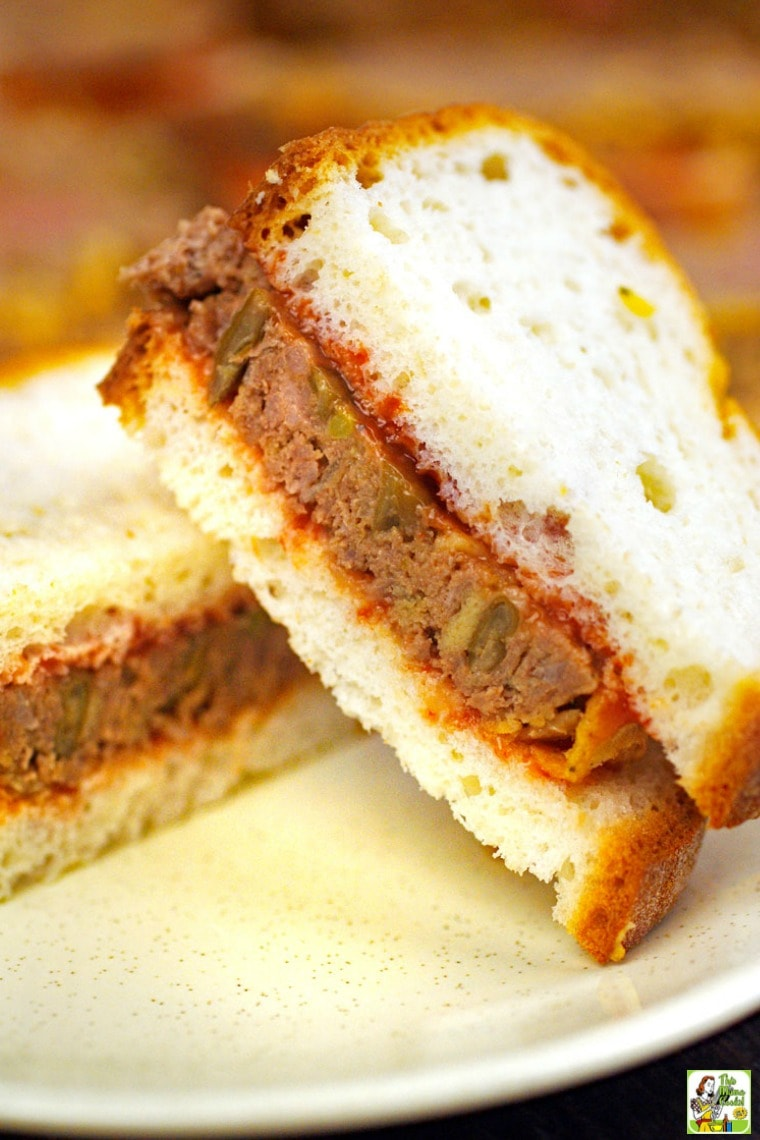 Closeup of a stack of Meatloaf Sandwiches on a white plate
