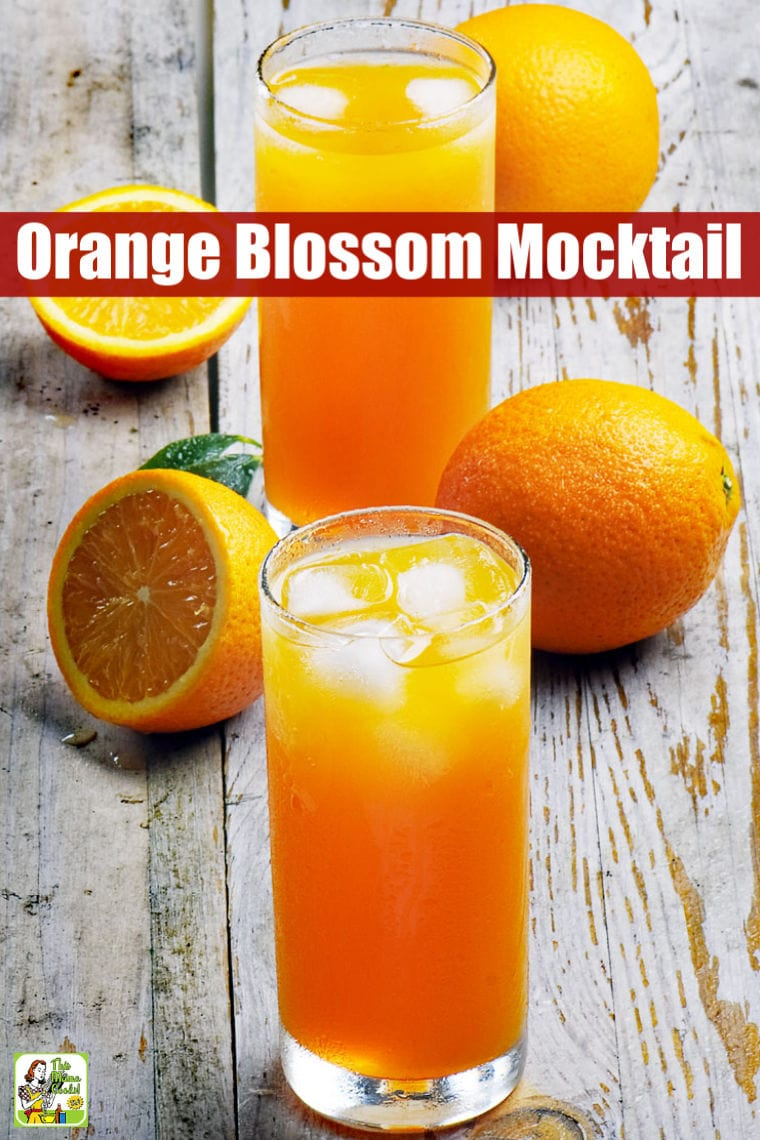 Glasses of Orange Blossom Mocktail and cut and whole oranges