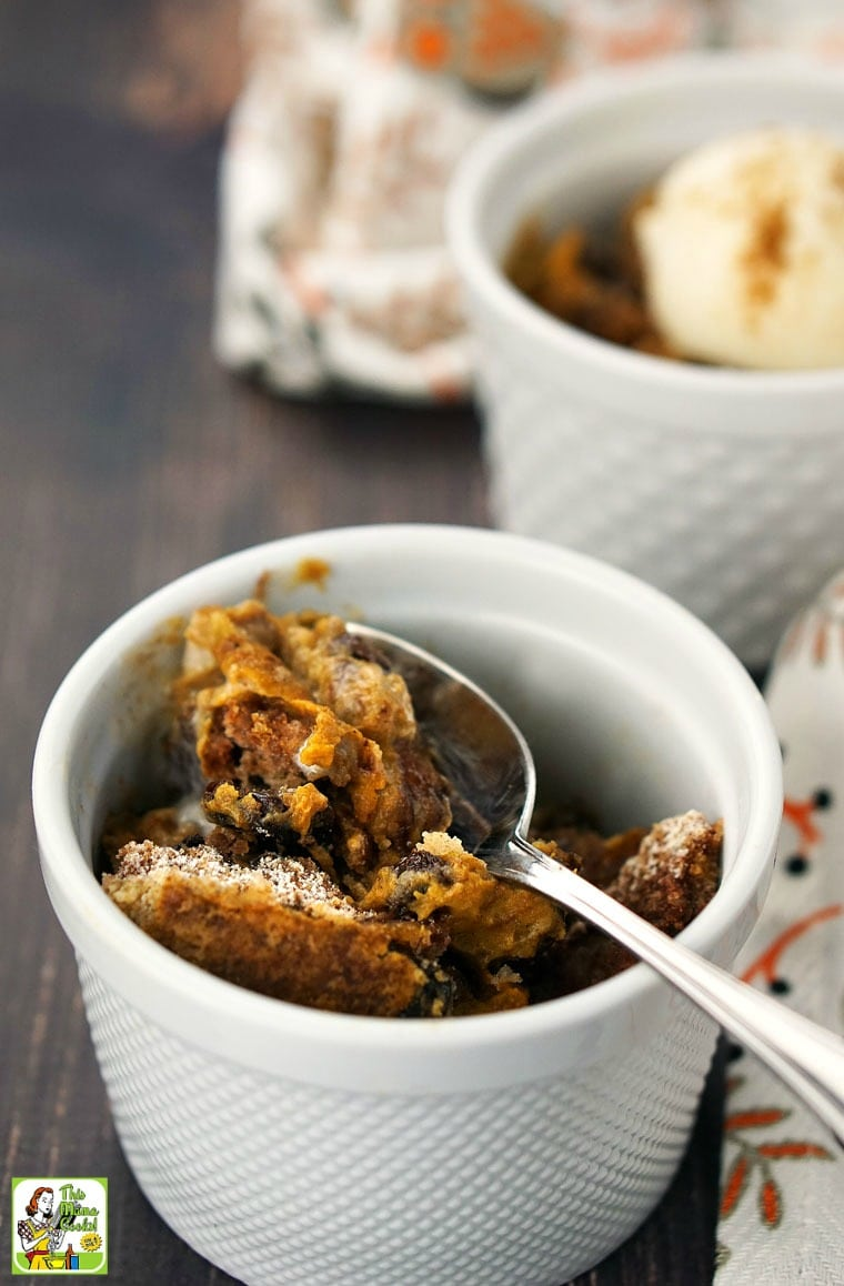 A bowl of pumpkin dump cake with a spoon.