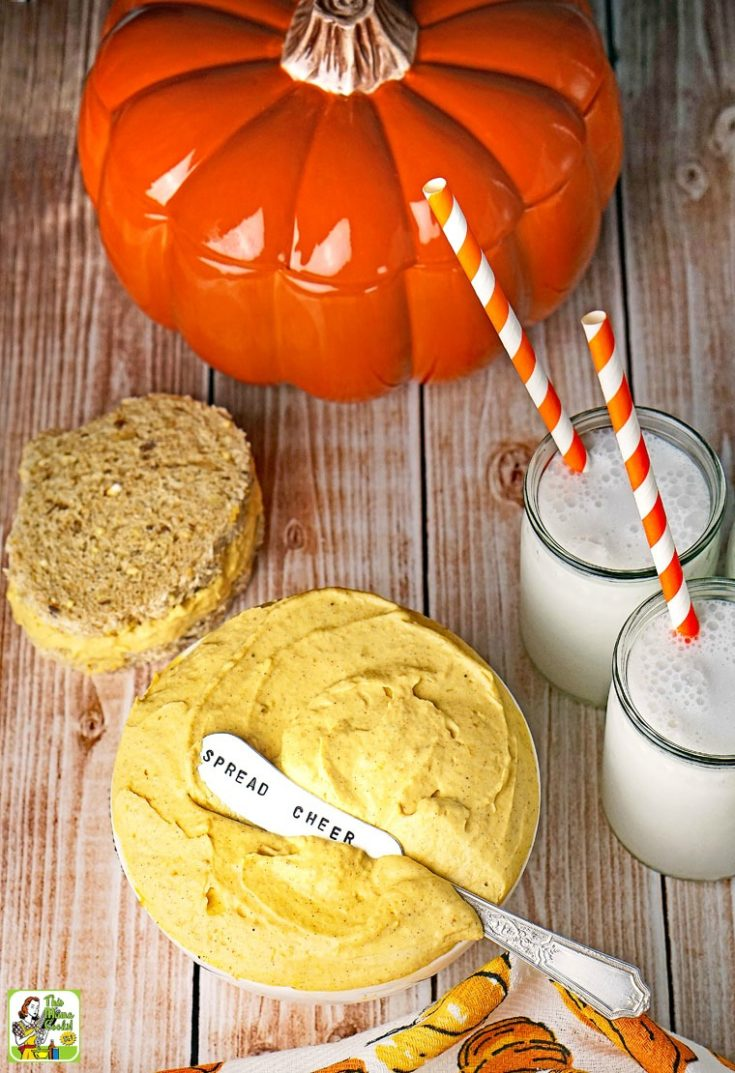 Low fat pumpkin dip in bowl with sandwich and milk