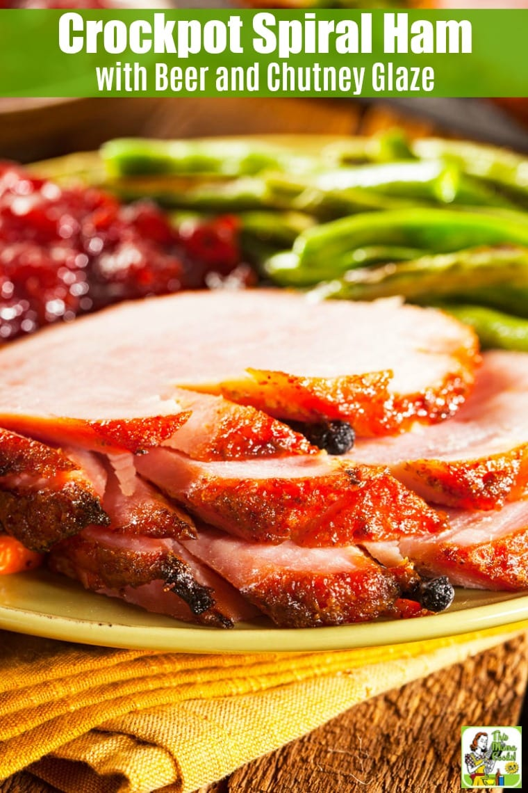 Slices of spiral cut ham with cranberry sauce and green beans