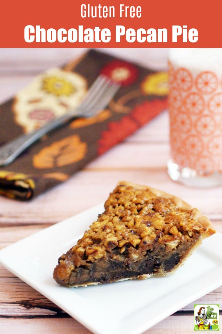 A slice of Gluten Free Chocolate Pecan Pie on a square white plate with a glass of milk and napkin in the background.