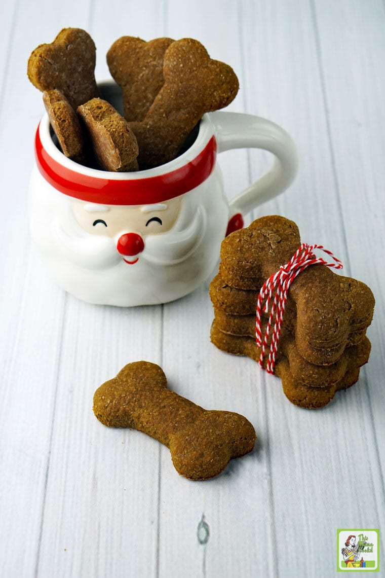 Dog treats in a Santa mug and wrapped in red string.