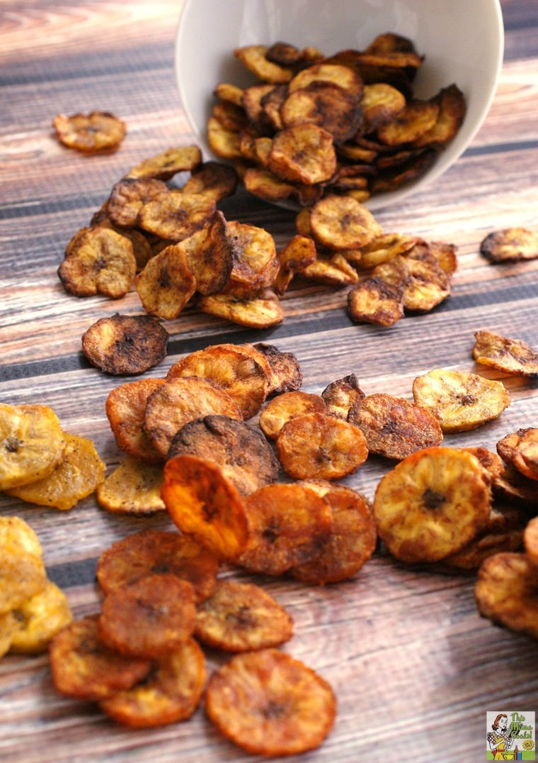 Spilled baked plantain chips on a tabletop.