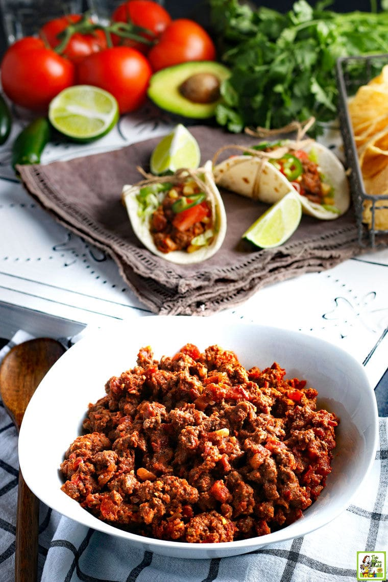 A white bowl of Crockpot Taco Meat with slow cooker tacos