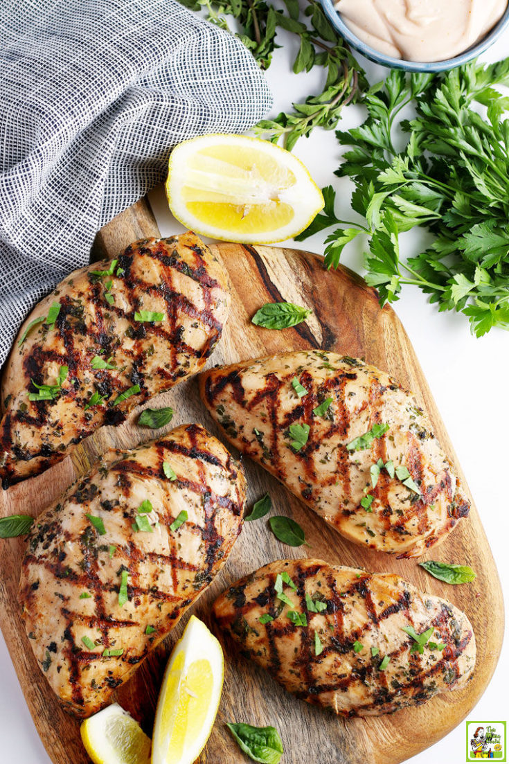 Grilled Marinated Chicken on a wooden cutting board.
