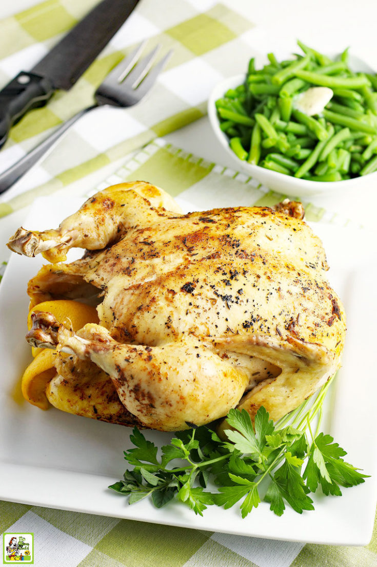 Cooked roasted chicken with a bowl of green beans